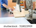 men at work sawing wood....   Shutterstock . vector #518023909