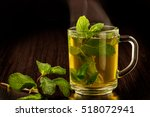 Cup With Green Tea Mint Leaves