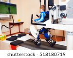 young boy passes robotic gait... | Shutterstock . vector #518180719