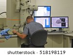 Scientist analyzes nanomaterials in a Transmission Electron Microscope
