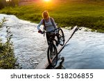 Lady With Bicycle Crossing The...