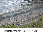 waves crashing on the shore of... | Shutterstock . vector #518214901