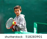 Little Tennis Player On A...