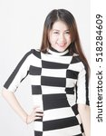 Small photo of Smile long hair business women akimbo wear plaid dress (chess board pattern) with different posing in studio
