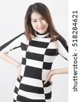 Small photo of medium shot smile business women akimbo wear plaid dress (chess board pattern) with different posing in studio
