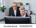two friendly men working behind ... | Shutterstock . vector #518285545