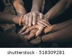 teamwork join hands support... | Shutterstock . vector #518309281