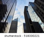 skyscrapers in a clear cloudy... | Shutterstock . vector #518330221