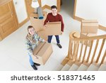 young couple moving in to new... | Shutterstock . vector #518371465