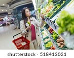 beautiful women shopping... | Shutterstock . vector #518413021