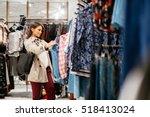 beautiful woman shopping trendy ... | Shutterstock . vector #518413024
