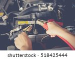 charging car battery with... | Shutterstock . vector #518425444