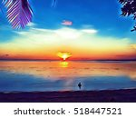 tropical beach on sunset.... | Shutterstock . vector #518447521