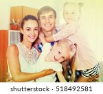 relaxed family of four smiling... | Shutterstock . vector #518492581