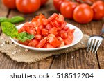 homemade cutted tomatoes on... | Shutterstock . vector #518512204
