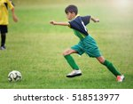 young boy playing soccer | Shutterstock . vector #518513977