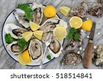 oysters on crushed ice with... | Shutterstock . vector #518514841