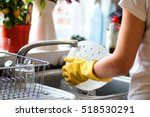 woman washing dishes in the... | Shutterstock . vector #518530291