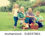 joyful family of four spending... | Shutterstock . vector #518557801