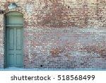 Old Wooden Door In A Brick Wall