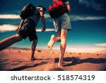 two hikers walking forward in... | Shutterstock . vector #518574319