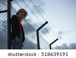 sad woman standing alone... | Shutterstock . vector #518639191