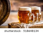 two glasses full of beer with... | Shutterstock . vector #518648134
