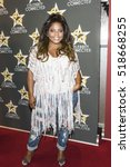 bre'ly evans arrives at... | Shutterstock . vector #518668255