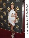 pamela jean noble arrives at...   Shutterstock . vector #518673865