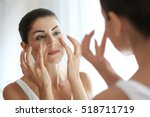 adult woman checking her face... | Shutterstock . vector #518711719