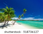 palm trees over white beach on... | Shutterstock . vector #518736127