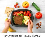 mother putting food in lunch... | Shutterstock . vector #518746969