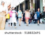 blurred image of walking people.... | Shutterstock . vector #518832691