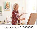 Senior Female Artist Painting...