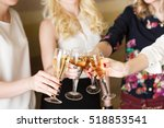 hands holding the glasses of... | Shutterstock . vector #518853541