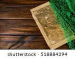 old book on wooden background. | Shutterstock . vector #518884294
