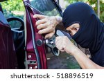 thieves trying to steal car. | Shutterstock . vector #518896519