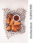 Small photo of take away breaded chicken wings with bbq dipping sauce