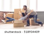 young couple moving | Shutterstock . vector #518934409