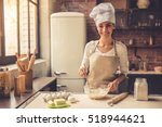 beautiful young woman in chef... | Shutterstock . vector #518944621