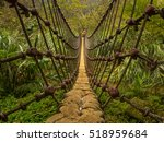 Rope Bridge Over A  River In...