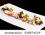 fine dining octopus carpaccio | Shutterstock . vector #518974219