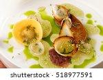 haute cuisine  roasted foie... | Shutterstock . vector #518977591