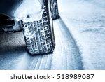 closeup of car tires in winter... | Shutterstock . vector #518989087