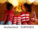 family in christmas socks near... | Shutterstock . vector #518992831