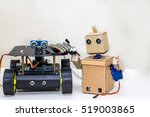 two robots are standing on the... | Shutterstock . vector #519003865