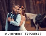 bride and groom hugging in a... | Shutterstock . vector #519005689