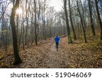 Man Running In Autumn Forest