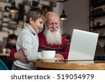 Grandfather And Grandson Using...