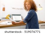 middle age woman at the office... | Shutterstock . vector #519076771